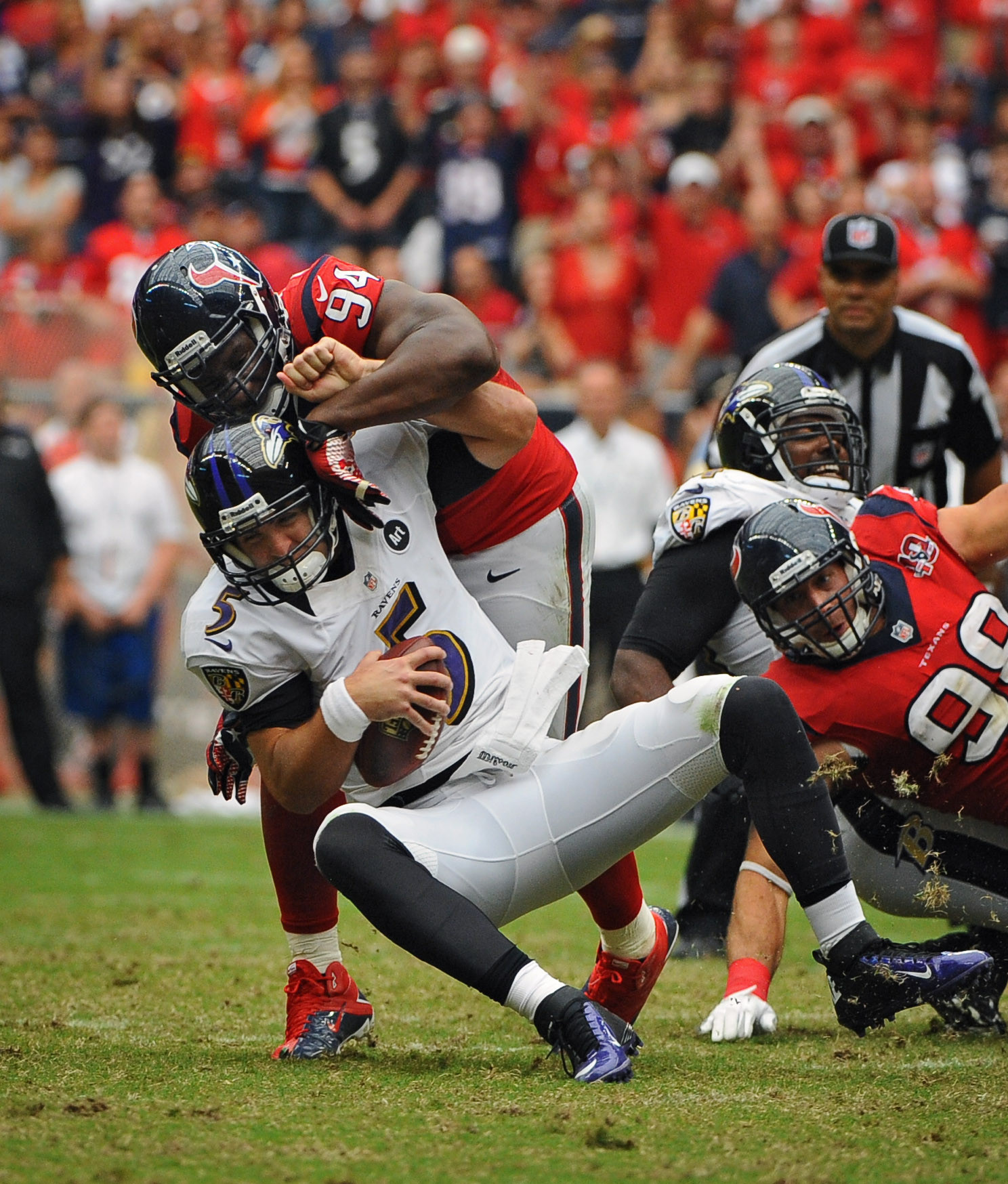 Joe Flacco is sacked by Houston's Antonio Smith.