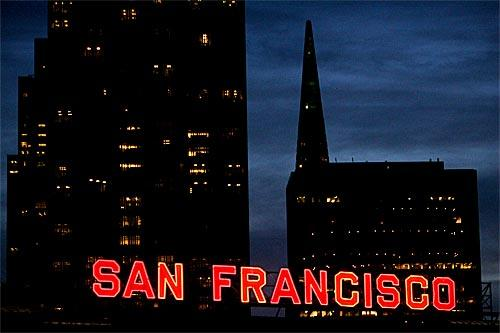 Thoughts of romance -- and weekend trips for valentines -- brings to mind San Francisco, a city with its share of romantic highlights. A neon sign lights up the city by the bay near the Ferry Building, with the Transamerica Pyramid in the background.