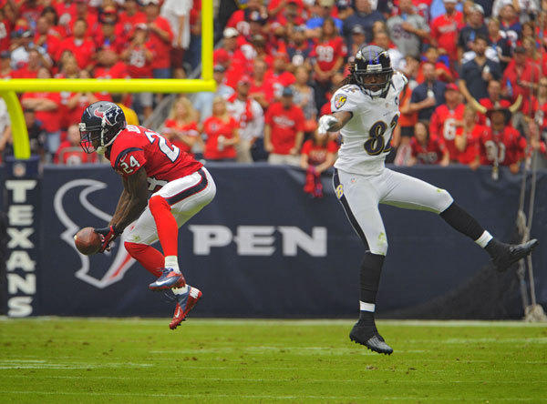 Houston Texans cornerback Johnathan Joseph (24) looks an interception of a pass by Baltimore Ravens quarterback Joe Flacco, intended for wide receiver Torrey Smith (82) that Jospeh runs back for a touchdown in the second quarter Sunday, Oct 21, 2012. Houston spanked the Ravens, 43-13.