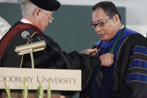 Chairman Board of Trustees Robert W. Kummer, Jr., left, puts on a medallion on Luis Ma R. Calingo during the inauguration and installation of Woodbury's 13th president, which took place at Woodbury University in Burbank on Saturday, October 20, 2012.