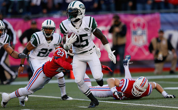 Joe McKnight #25 of the New York Jets gains yardage against the New England Patriots in the first half at Gillette Stadium on October 21, 2012 in Foxboro, Massachusetts.