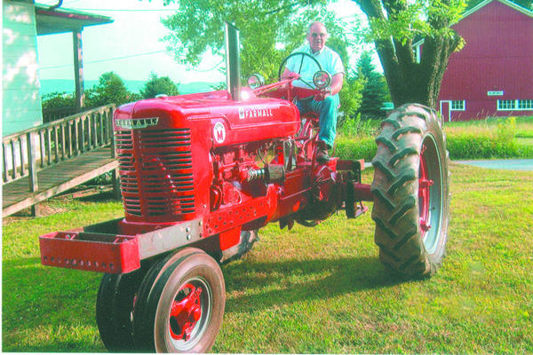 F. Carl Walker sits upon a 1941 Farmall M tractor early on the same evening that he was honored as a 50-year continuous member of the Hillcrest Grange near Berlin. The tractor came on the market the same year that Walker was born into a farm family in Summit Township. Throughout his 50 years of membership, Walker has been continually active as an officer, committee member and he has assisted with putting together booths at the Somerset County Fair for more than 40 years. For the past 10 years, he and his wife, Fay, have been the chairpersons for Hillcrest's food booth at Mountain Craft Days.