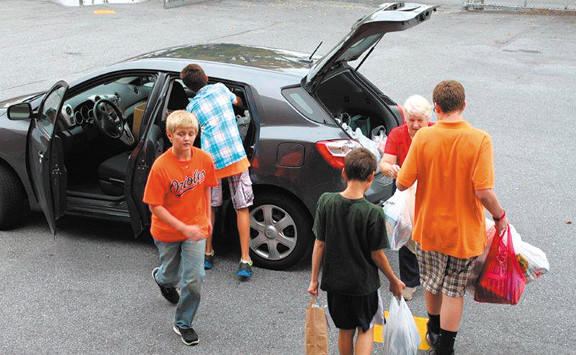 Shown loading the car for delivery are student council members Seamus Murray, William Jones, Nick Judge, Jared Semler and Catholic Daughters member Linda Field.
