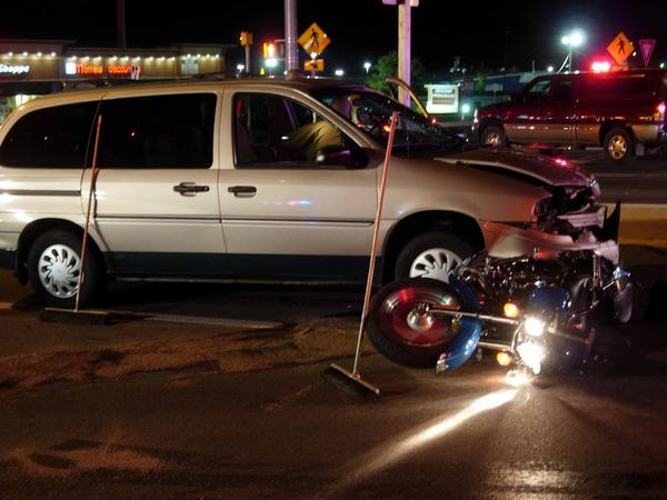 A van ran into a motorcycle stopped at a red light at the intersection of Halfway and Massey boulevards Sunday night.
