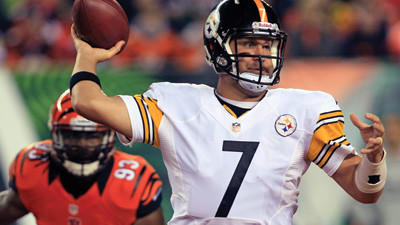 Pittsburgh Steelers quarterback Ben Roethlisberger passes under pressure from the Cincinnati Bengals during the first half of an NFL football game Sunday in Cincinnati.