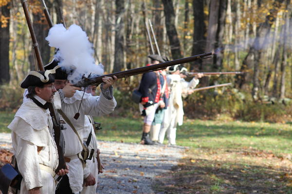 American forces open fire during  recreation of an American Revolutionary War battle held at the Nathan Hale Homestead in Coventry Saturday afternoon.