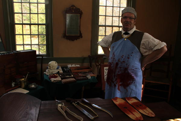 Daniel Newman, of Pomfret, Conn., sets up his surgeons office in the parlor of the Nathan Hale Homestead during the recreation of the American Revolutionary War Encampment on Saturday.