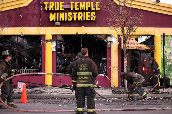 Firefighters work the scene of an extra alarm fire at True Temple Ministries in East Garfield Park.