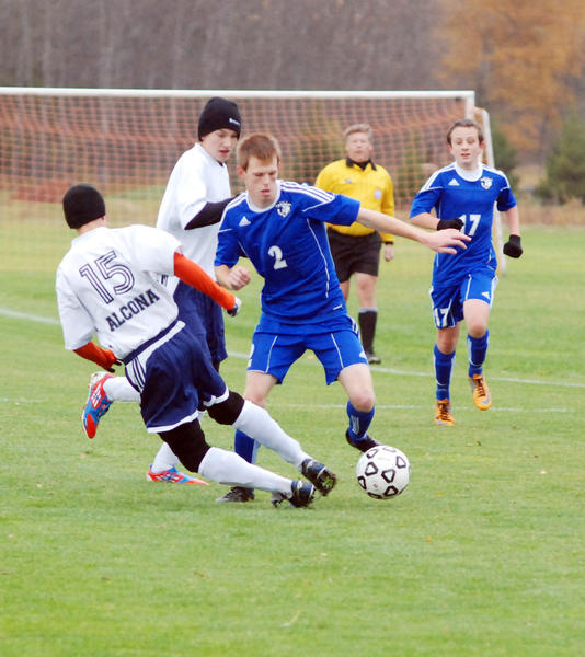 Burt Lake Northern Michigan Christian Academy's Aaron Chatfield (right) scored both Eagle goals Friday during a 3-2 loss to Lincoln-Alcona Friday in a Division IV district final match at the Click Road Soccer Complex.