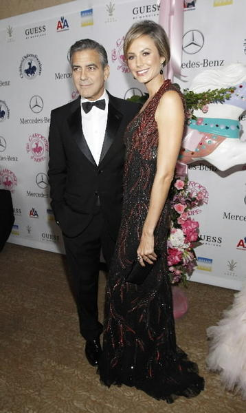 Actor George Clooney and girlfriend Stacy Keibler at the 26th annual Carousel of Hope Ball in Beverly Hills, Calif., on Oct. 20. Clooney received the Ball's Brass Ring Award for his outstanding artistic achievements and his work as a humanitarian. The event benefits the Barbara Davis Center for Childhood Diabetes.