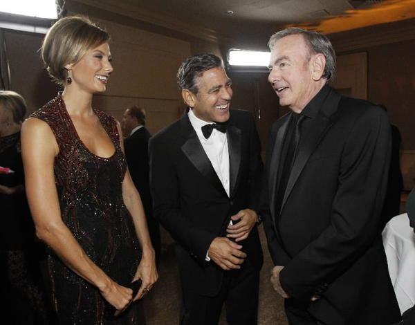 George Clooney and Stacy Keibler smile with singer Neil Diamond during the 26th Carousel of Hope Ball.