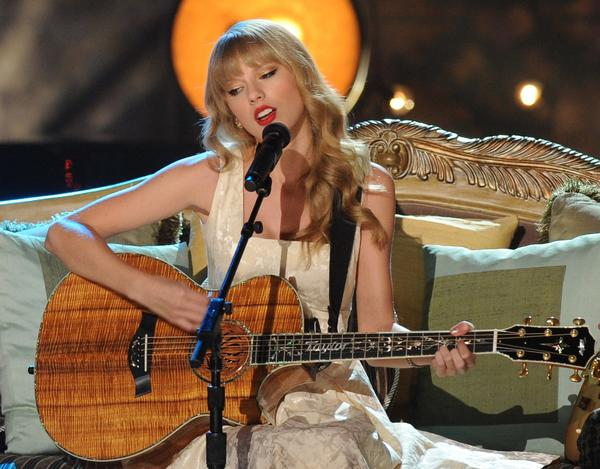 Taylor Swift says she designed her new album 'Red' to take listeners on a journey through the ups and downs of love and life.