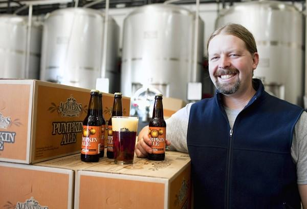 Geoff Logan, a brewmaster, is shown with Pumpkin Ale at Williamsburg AleWerks on Thursday, October 11, 2012. The AleWerks has been a local microbrewery since 2006. They make seasonal beers like Pumpkin Ale and other year-round ones.