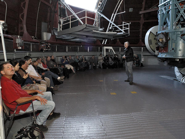 Astronomy buffs listen to Mt. Wilson Observatory Superintendent David Jurasevich talk about the 60-inch telescope at right during an astrophotography workshop at the historic facilities on Sunday, Oct. 14, 2012. The class, first of its type and sponsored by Canon USA and Samy's Camera, brought 25 astrophotography enthusiasts to the observatory high above the city of Pasadena for a night of star photography. The students were able to take some photos through the 60-inch telescope.