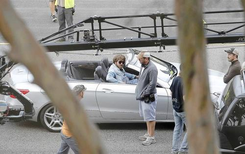 "Actor Zach Galifianakis, sitting in the car, waits as crew members set up a shot during filming of ""The Hangover Part III"" in Costa Mesa on Saturday."
