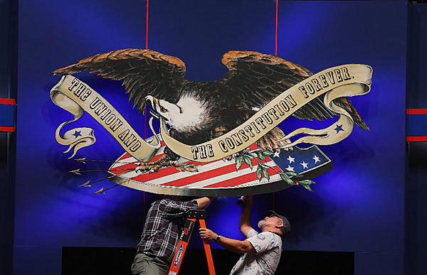Workers add the finishing touches to the stage for the debate tonight at Lynn University in Boca Raton, Fla. President Obama and Republican candidate Mitt Romney square off for the final time on Oct. 22, before the main election on Nov. 6.