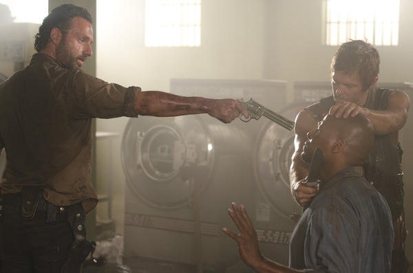 Rick Grimes (Andrew Lincoln) and Daryl Dixon (Norman Reedus) confront a prisoner.