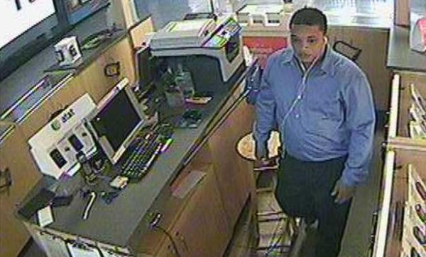 This image from surveillance video released by Martinsburg (W.Va.) Police shows a robbery in progress at an AT&T kiosk at Martinsburg Mall shortly after 8 a.m. on Oct. 19. Mobile phones valued at more than $20,000 were stolen from two kiosks at the mall.