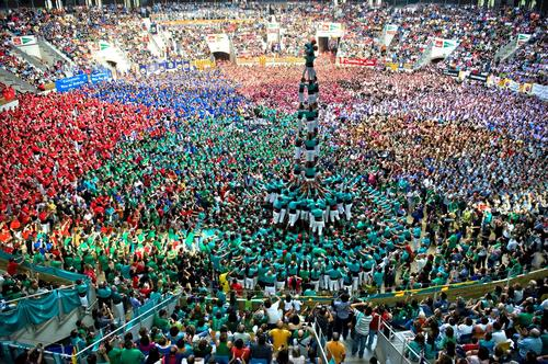 Team Castellers de Vilafranca  (teal shirts) forms a human tower at the Tarragona Castells Competition.
