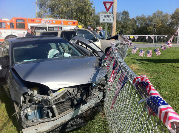 A Nissan Maxima sedan, in foreground, and a Ford Explorer SUV came to rest against a fence following a three-vehicle crash Monday afternoon at the traffic circle linking Cearfoss Pike, Greencastle Pike and Fairview Road.
