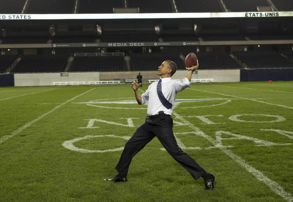 Obama at Soldier Field throwing a football