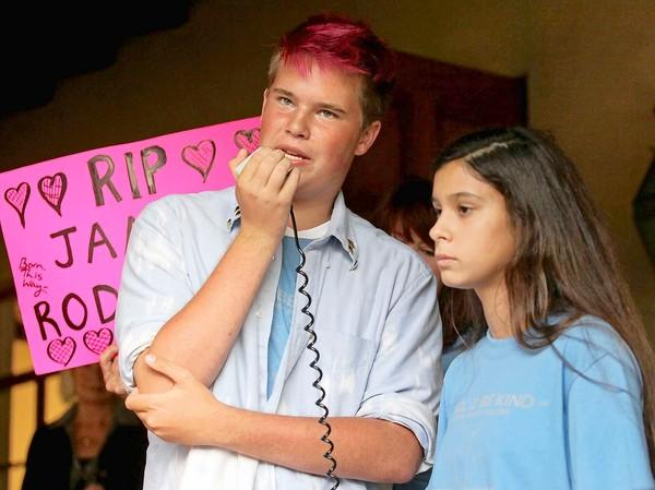 Anti-bullying advocate Jonah Mowry, left, of Lake Forest, stands with Victoria Mendoza, of San Clemente, as he speaks during an anti-bullying rally at Laguna Beach City Hall on Friday.