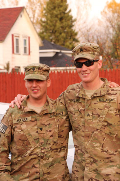 Spc. Dwayne Aulgur (left) and Sgt. Zack Bellmer, members of the Army National Guard, are shown following their return home to Emmet County.