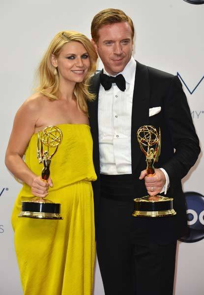 Actors Claire Danes and Damian Lewis pose in the 64th Annual Emmy Awards press room.