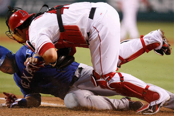 Former Angels catcher Bobby Wilson, shown colliding with another ex-Angels catcher, Texas' Mike Napoli, has been claimed off waivers by Toronto, where Wilson will join yet another former Angels catcher, Jeff Mathis.