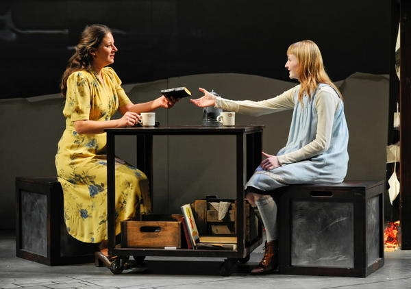 "Ilsa (Nicole Wiesner) gives a blank book to Liesel (Rae Gray) in ""The Book Thief"" from Steppenwolf for Young Adults."