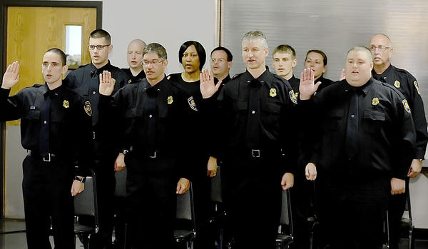 Eleven correctional officers take the Correctional Professional Oath at a commencement ceremony Monday at the Fairplay Fire Hall. The graduates are Aleksey Mikvov, Eliud Ortiz, Michael Christman, Nathan Ellis, Theodore McLaughlin, Andrea Weeks, Wayde Yeager, Douglas Hoffman, Joseph Palko, Eric Wariner and Mary Absher.