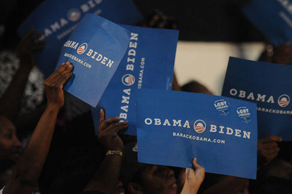 Supporters hold up Obma-Biden signs as Michelle Obama spoke at the George Mayer Gymnasium at Broward College in Davie, Florida on Monday, October 22, 2012.