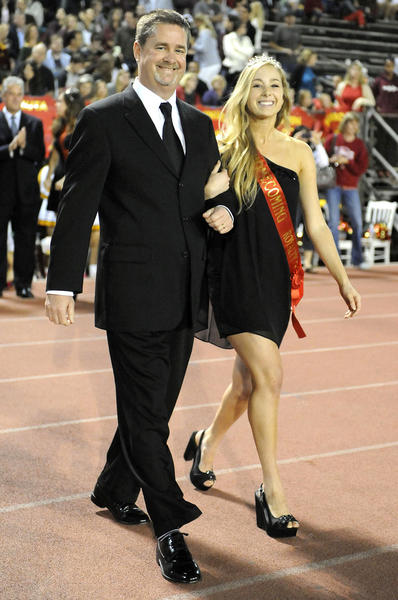 Senior Hannah Gunter is escorted by her father Rick as she is introduced during halftime of a Rio Hondo League prep football between South Pasadena and La Canada at La Canada High School on Friday, Oct. 19, 2012.