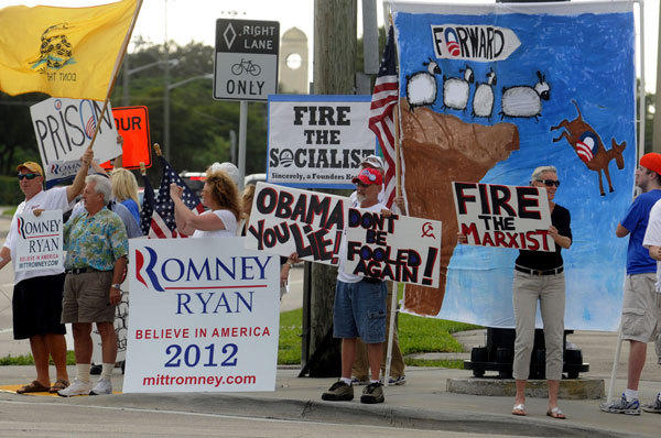 Mitt Romney supporters demonstrate on Yamato Road near Lynn University on the eve of the presidential debate.