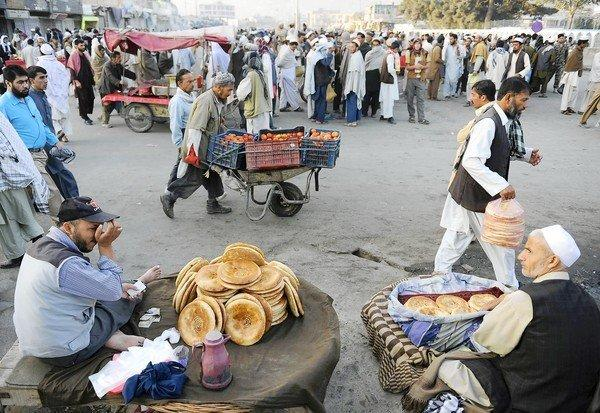Street vendors offer goods at a market in Kabul, Afghanistan. There is a growing sense of unease among Afghans as foreign troops prepare to withdraw from the country.