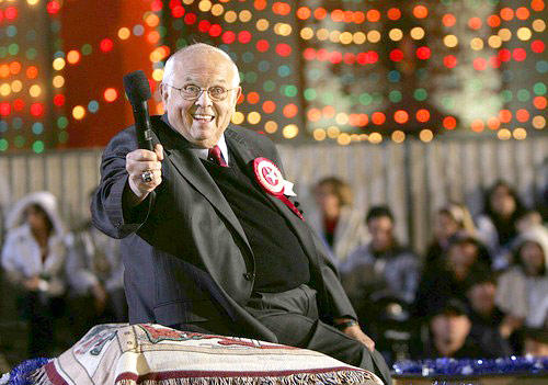 Johnny Grant, honorary mayor of Hollywood, flashes a smile in front of Grauman's Chinese Theatre during the 75th annual Hollywood Christmas Parade in 2006.