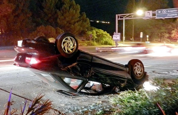 A car crashes on the Foothill (210) Freeway Sunday night.