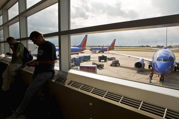 Flights through Midway Airport, above, cost 14 percent more during the Christmas holiday.