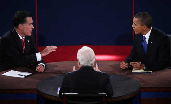 President Obama debates with Republican presidential candidate Mitt Romney as moderator Bob Schieffer looks on at Lynn University in Boca Raton, Fla.