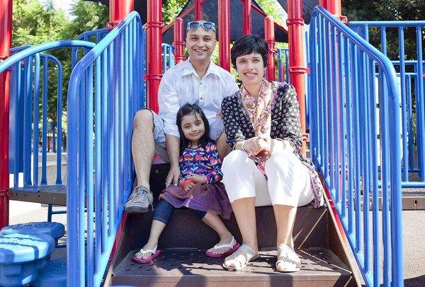 """Apurva Pande, left, and Chinmaya Misra live in an airy loft in a century-old building at 7th and Olive with their daughter Anvaya Pande. Says Misra: """"You look around and realize, 'where am I going to educate my child?'"""""""
