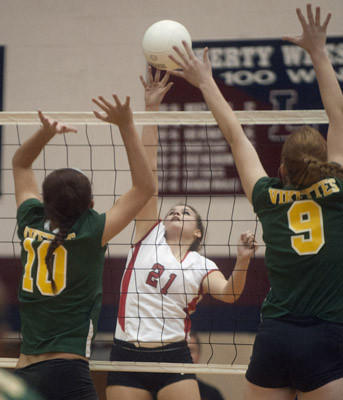 Parkland's Veronica Koval hits against Central Catholic's Steph Kovacs (10) and Darcy Wolf (9) in the Lehigh Valley Conference girls volleyball semifinals at Liberty.