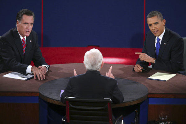 Republican presidential nominee Mitt Romney and President Obama answer a question during the third presidential debate at Lynn University in Boca Raton, Fla.