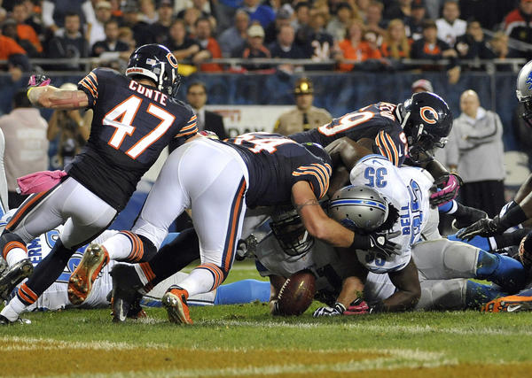 Brian Urlacher #54 of the Chicago Bears recovers a fumble on the one yard line against the Detroit Lions on October 22, 2012 at Soldier Field in Chicago, Illinois. Chicago won 13–7.