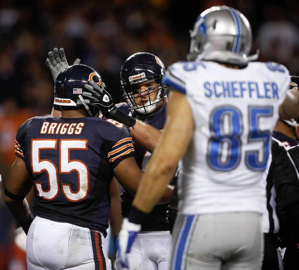 Brian Urlacher after Lance Briggs recovers a fumble from the Lions in the third quarter.