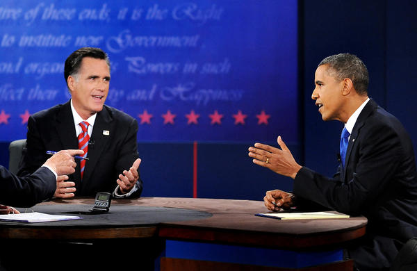 President Barack Obama, right, speaks during a debate with Republican presidential candidate Mitt Romney, left, at Lynn University in Boca Raton, Florida on Monday, October 22, 2012. Bob Schieffer is the moderator.