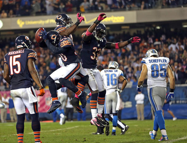 DJ Moore, Charles Tillman and Major Wright celebrate a failed 4th down conversion by the Lions in the 4th quarter.