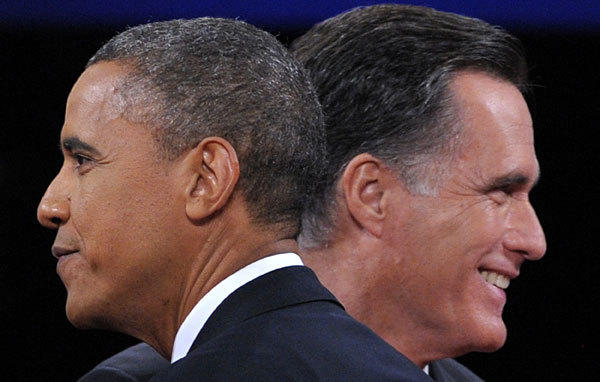 President Barack Obama greets Republican presidential candidate Mitt Romney after the final presidential debate.