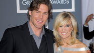 "<span style=""font-size: small;"">Carrie Underwood is in the midst of her Blown Away Tour, as her husband Mike Fisher keeps busy despite the NHL lockout. Carrie admits that Mike normally doesn't join her on the road, as he is keeping his Nashville Predators on his mind. (Audio) ""Well, he has to stay home, he can't just come out on tour with us. He has to be able to work out and train and skate, and all that stuff. And keep himself ready. He's a very dedicated person, and he wants to be ready for whenever they do start playing again."" Mike recently re-signed his contract to remain with the Preds for two more years for a reported $8.4 million deal. By the way, Carrie has the #1 song for the second week in a row, as ""Blown Away"" tops the charts. Carrie is the only female singer to be on top of the country charts for three weeks in 2012 – ""Good Girl"" also went #1.</span>"