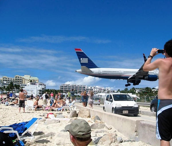 My husband and I live in Perry Hall and we cruised from the Port of Baltimore to the Southern Caribbean in 2011. While on the Dutch side of St. Maarten, we visited Maho Beach. A friend we were traveling with took this picture of a plane landing at Princess Juliana International Airport. This airport accommodates direct flights to/from cities in the USA, Europe and Canada. The beach is separated from the runway tarmac by a narrow road. Aircraft pass over the beach at an altitude of between 30 and 60 feet. What a sensation!