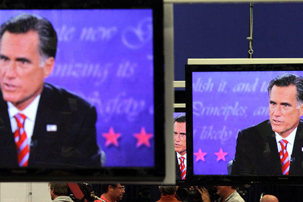 Gov. Mitt Romney is shown on televisions in the media center during the final 2012 Presidential Debate held Monday, Oct. 20, 2012, at Lynn University in Boca Raton.